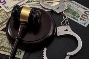 Gavel, Handcuffs and Money